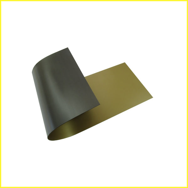 Photo shows piece of flexible gold colored magnetic material. Material is black on the magnetic side.