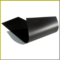 Photo shows sheet of thin and flexible magnetic material. Color is black.