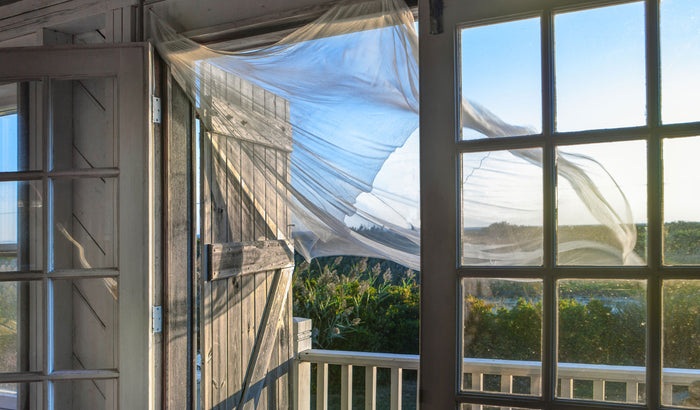 Summer breeze at open window in beach house