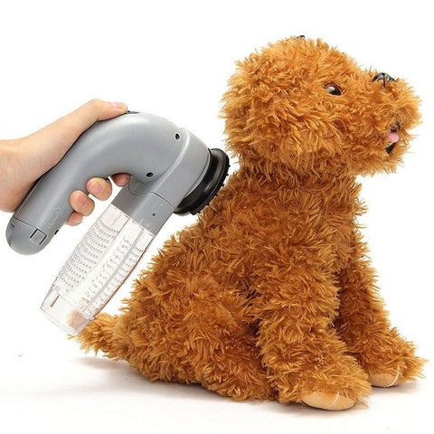 Pet hair grooming vacuum