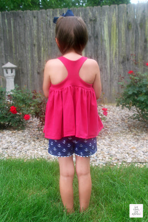 Girl's hot pink racerback tank top with anchor embroidery and navy tulip shorts with anchors
