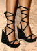 Women's winter and fall black suede tie up multi way strap wedge heel.