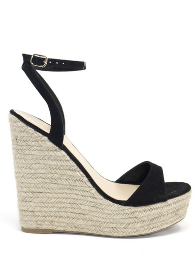 Alyssa B Espadrille Wedge in Black. Black suede ALYSSA wedge with espadrille wedge that crisscross strap that crosses in the back as the buckle buckles in the side that is silver. Thick to thin back to thick strap in the front.