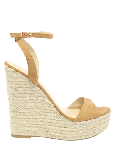 Camel suede ALYSSA wedge with espadrille wedge that crisscross strap that crosses in the back as the buckle buckles in the side that is silver. Thick to thin back to thick strap in the front.