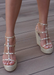 Astrid Espadrille Wedges in Gold that has a espadrille wedge and multi strap gold studded wedge.