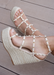 Astrid Espadrille Wedges in Nude that has a espadrille wedge and multi strap gold studded wedge.