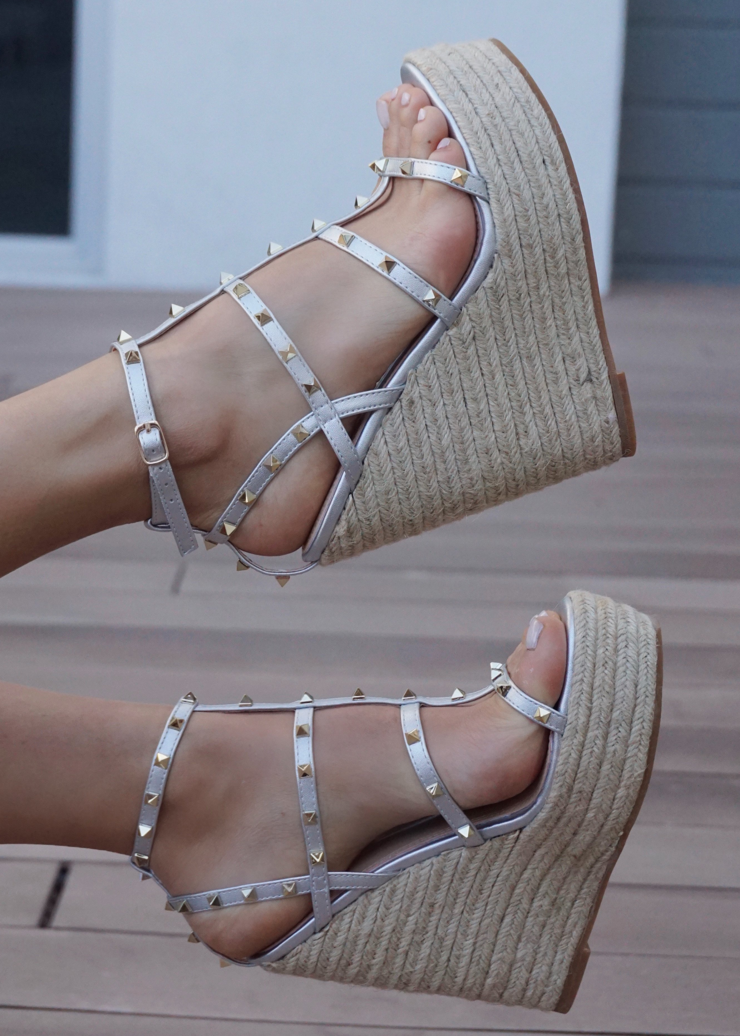 Astrid Espadrille Wedges in Silver that has a espadrille wedge and multi strap gold studded wedge.