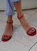 Close up of @carlanunez_ in our Aria red jelly sandals. Front view