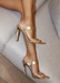 Audrey Heels with Clear Strap in Gold. Audrey Heels with Clear Strap in front where the feet are and gold strap  on the bridge of foot. Has a point sole and you slip it on and off.  The back is always showing and free.
