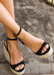 Black suede ALYSSA wedge with espadrille wedge that crisscross strap that crosses in the back as the buckle buckles in the side that is silver. Thick to thin back to thick strap in the front. FRONT VIEW