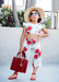 @gracesfunhouse in her weekend two piece flower set accessorized with our kids scarlet jelly sandals.