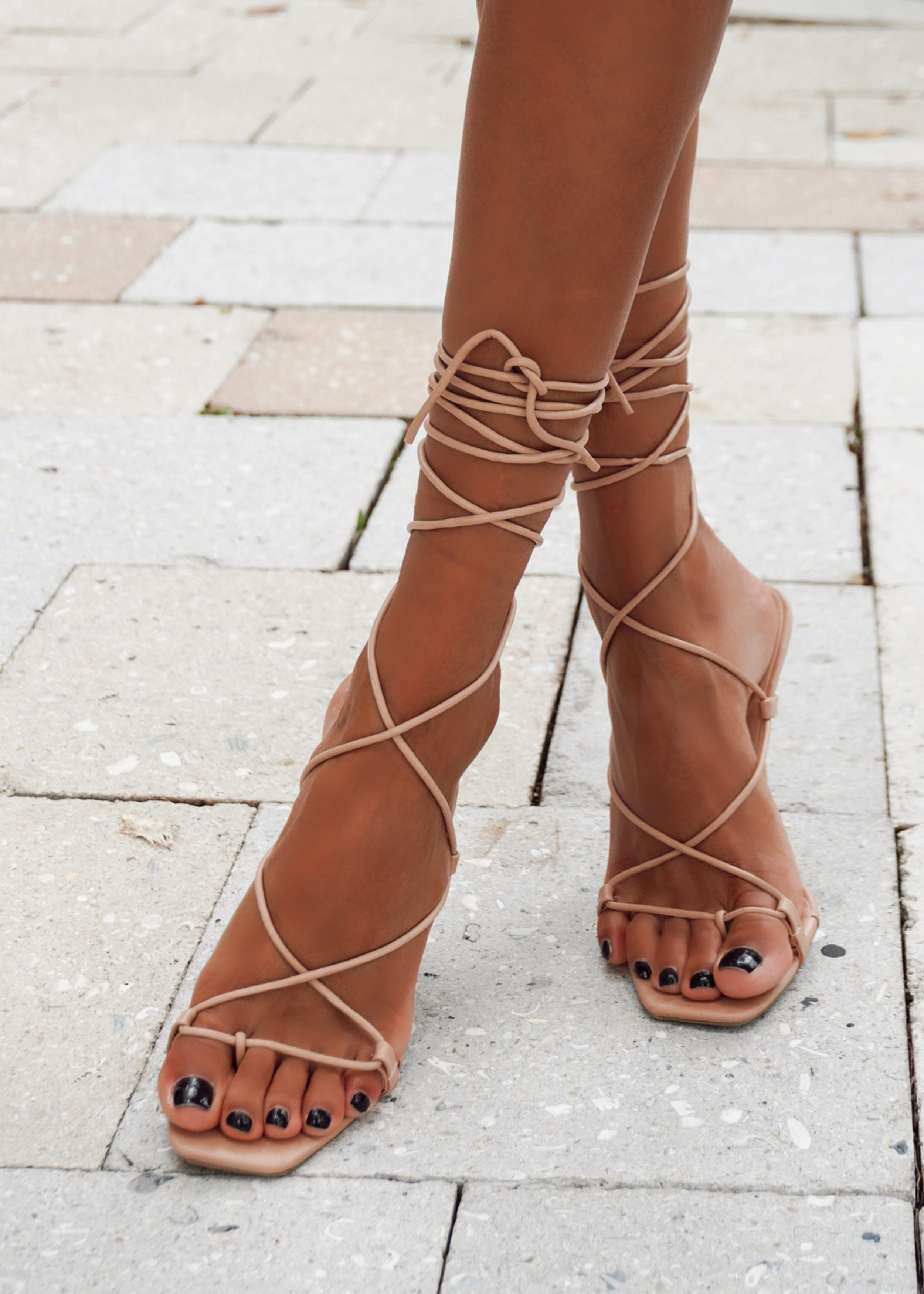 "Our women's nude sleek tie up stiletto, the ""Ana"" heel, on tropical vacations for night time fun or to a wedding paired with a beautiful dress or grown! The Ana heel features thong-like toe straps and skinny ankle laces which tie up real high to ensure a secure and comfy fit while exuding high end elegance."