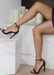 Ali Heels in Black that has a buckle on the ankle and cover heel in the back as well as thick to thin and thick again for secure and comfort. Side view