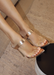 Audrey Heels with Clear Strap in RoseGold.  Audrey Heels with Clear Strap in front where the feet are and rose gold strap  on the bridge of foot. Has a point sole and you slip it on and off.  The back is always showing and free.