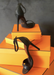 Our Black Ali sandal heels propped up on orange boxes.