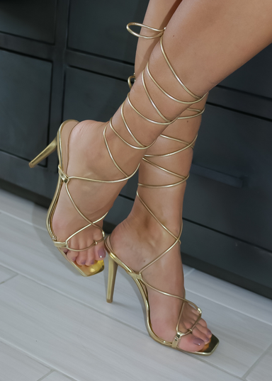 ANA HEEL is a women's gold tie up heel sandal that you can wear different ways.