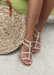 Ava gladiator Sandals in Gold  on the beach paired with a beach bag,