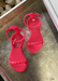 Little Girl's neon pink  sandals. kids aria sandals with sparkle gold sole and gold studded strap in the front and on in the back that buckles