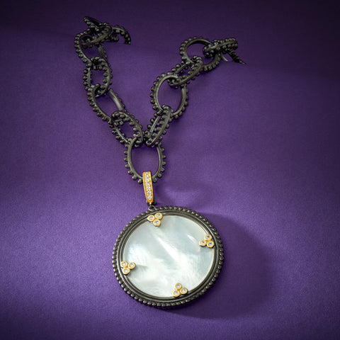 Mother of pearl linked pendant necklace with purple background