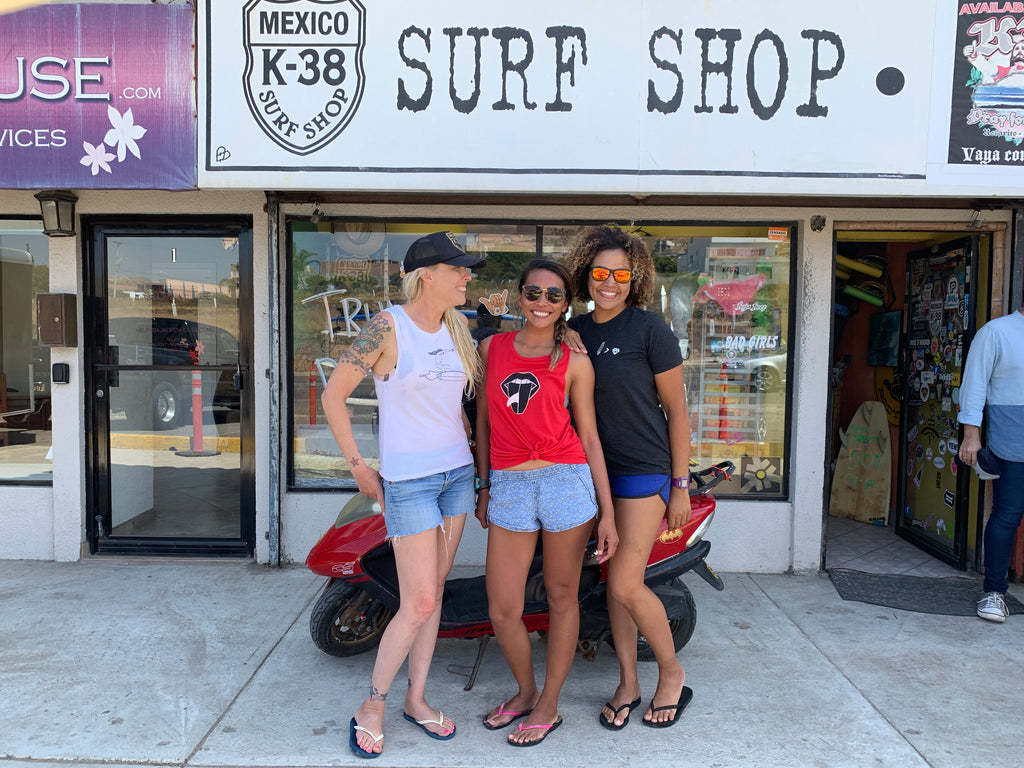 K38 surf shop wearing her waves tanks tees