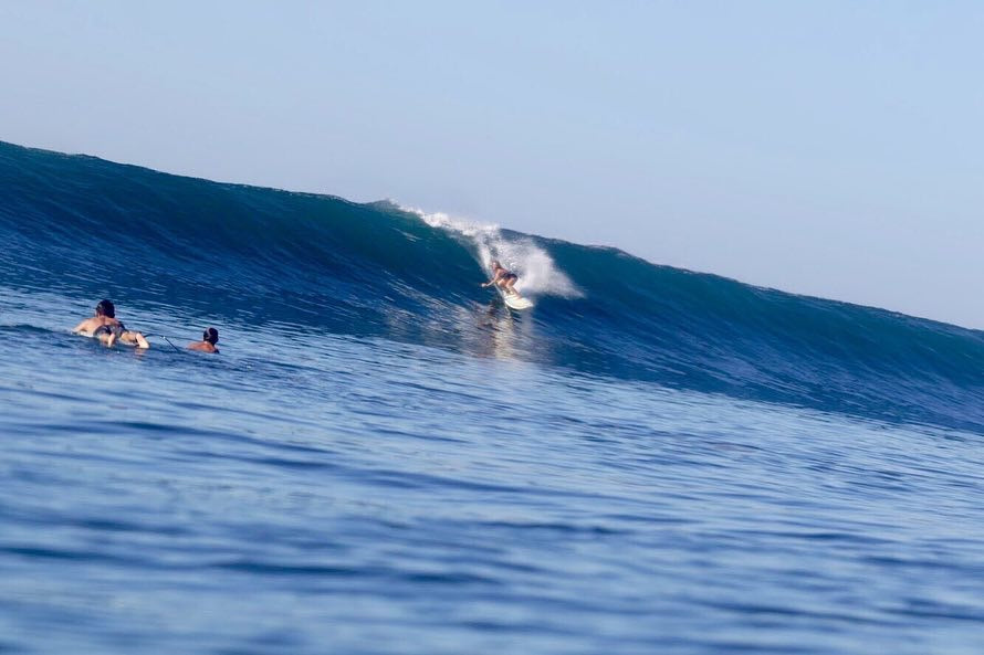 Candice surfing Sunzal her waves