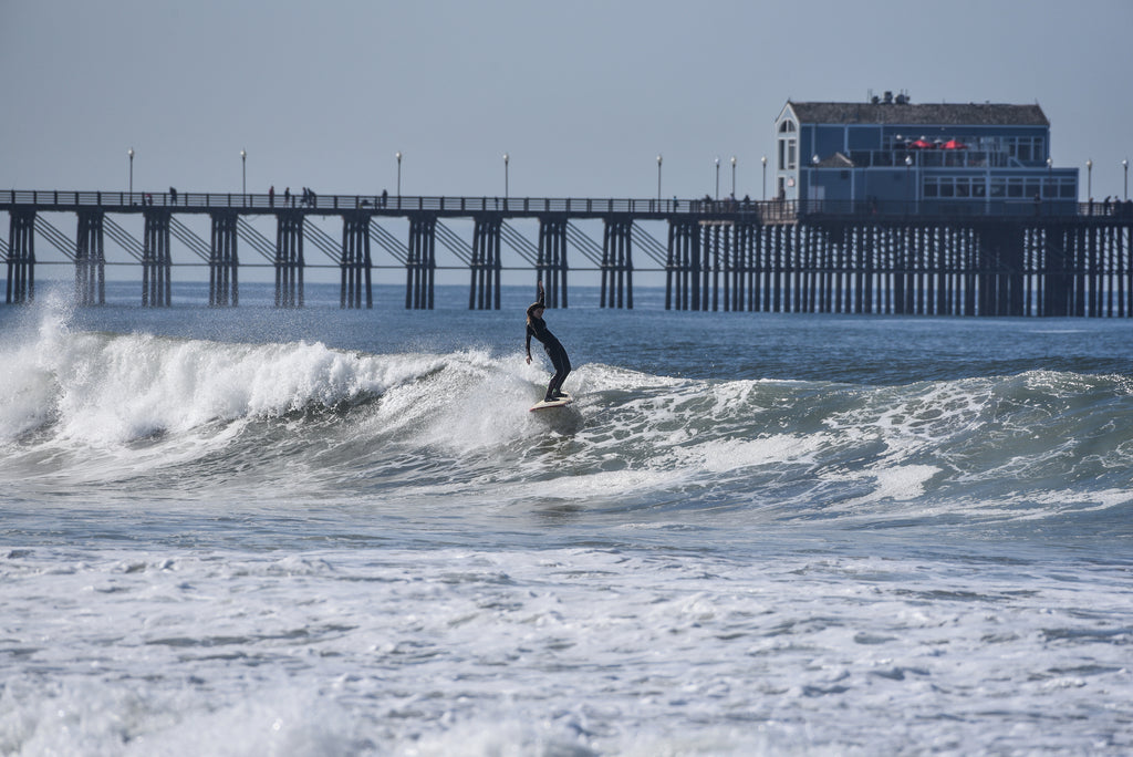 Deana hand up surfing oceanside her waves