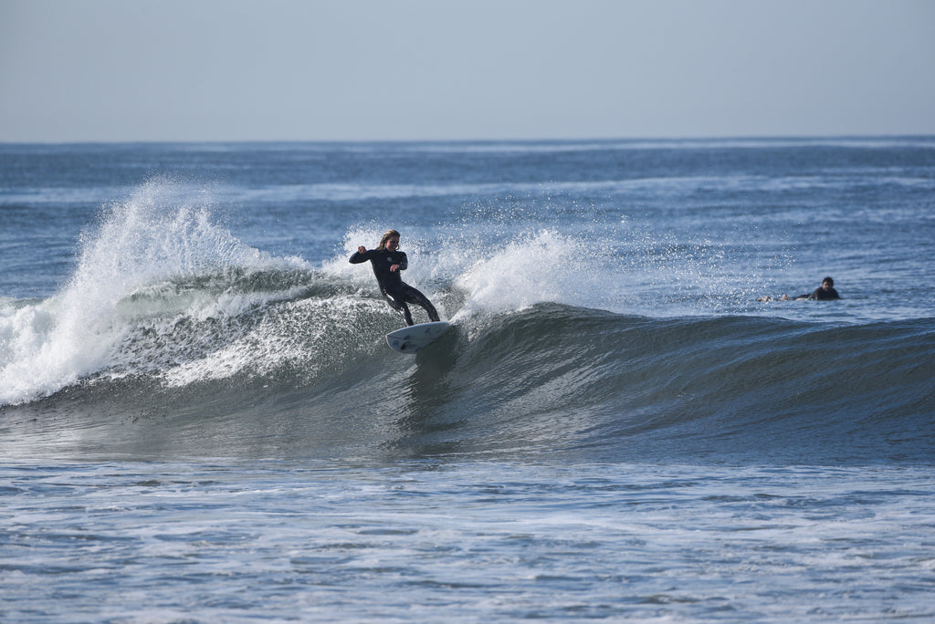 girl surfing oceanside her waves