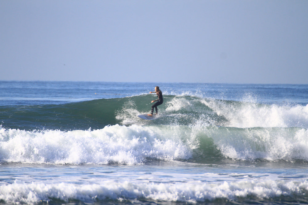surfing baja her waves