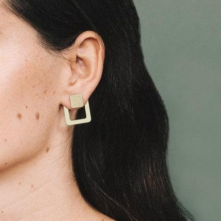 square, ear jacket, brass, on model.