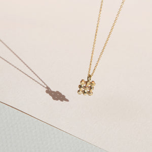 gold filled chain, lobster clasp, small brass pendant, crosshatch design