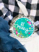 "Load image into Gallery viewer, Hand Painted Clear Acrylic Teal Ornament, ""Be Merry"" - Bethany Joy Art"