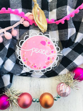 "Load image into Gallery viewer, Hand Painted Clear Acrylic Light Pink Ornament, ""Peace"" - Bethany Joy Art"