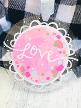 "Load image into Gallery viewer, Hand Painted Clear Acrylic Light Pink Ornament, ""Love"" - Bethany Joy Art"