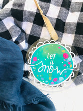 "Load image into Gallery viewer, Hand Painted Clear Acrylic Teal Ornament, ""Let it Snow"""