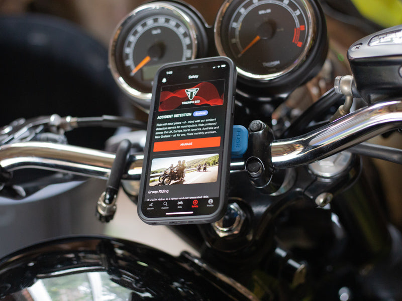 triumph sos app mounted to triumph motorcycle with quad lock