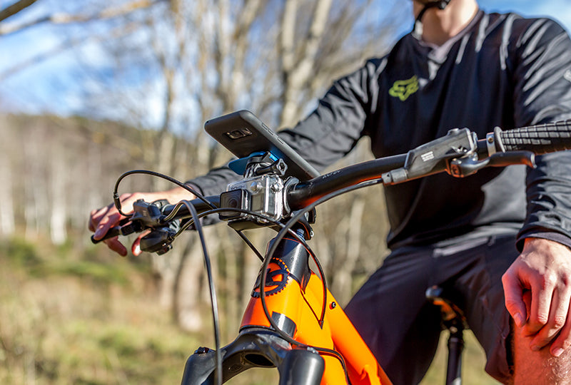 Galaxy Smartphone Attached To Out Front Mount On Mountain Bike Handlebars With GoPro