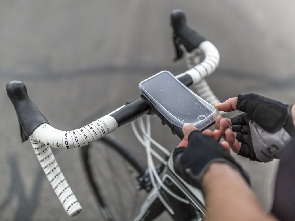 placing weather resistant poncho on smartphone mounted to bike