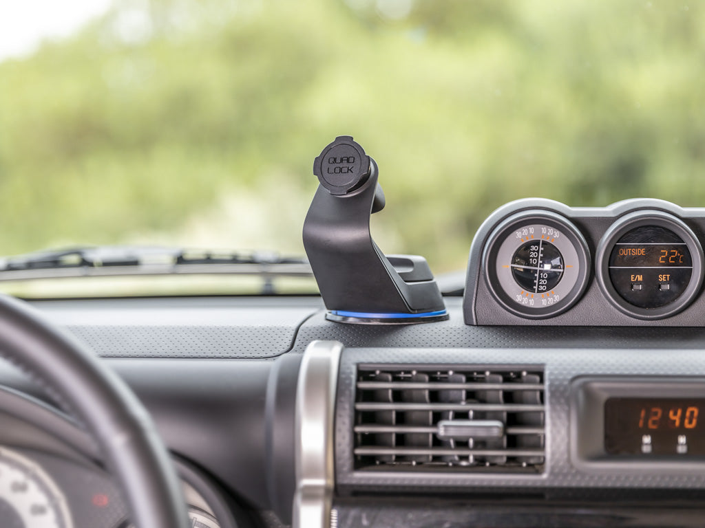 smartphone car mount on dash of car