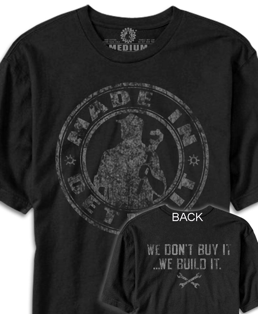 Made In Detroit Wrenchman distressed design printed on Black T-shirt. Back (We don't buy it.. We build it)