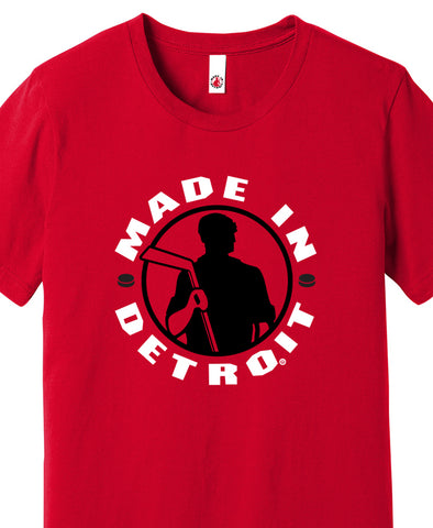 Made In Detroit Wrenchman holding a hockey stick. Printed in black/white on Red T-shirt
