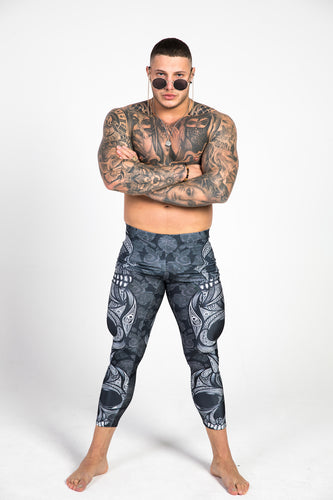 man wearing back skull leggings