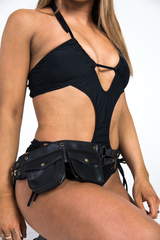woman with black leather belt