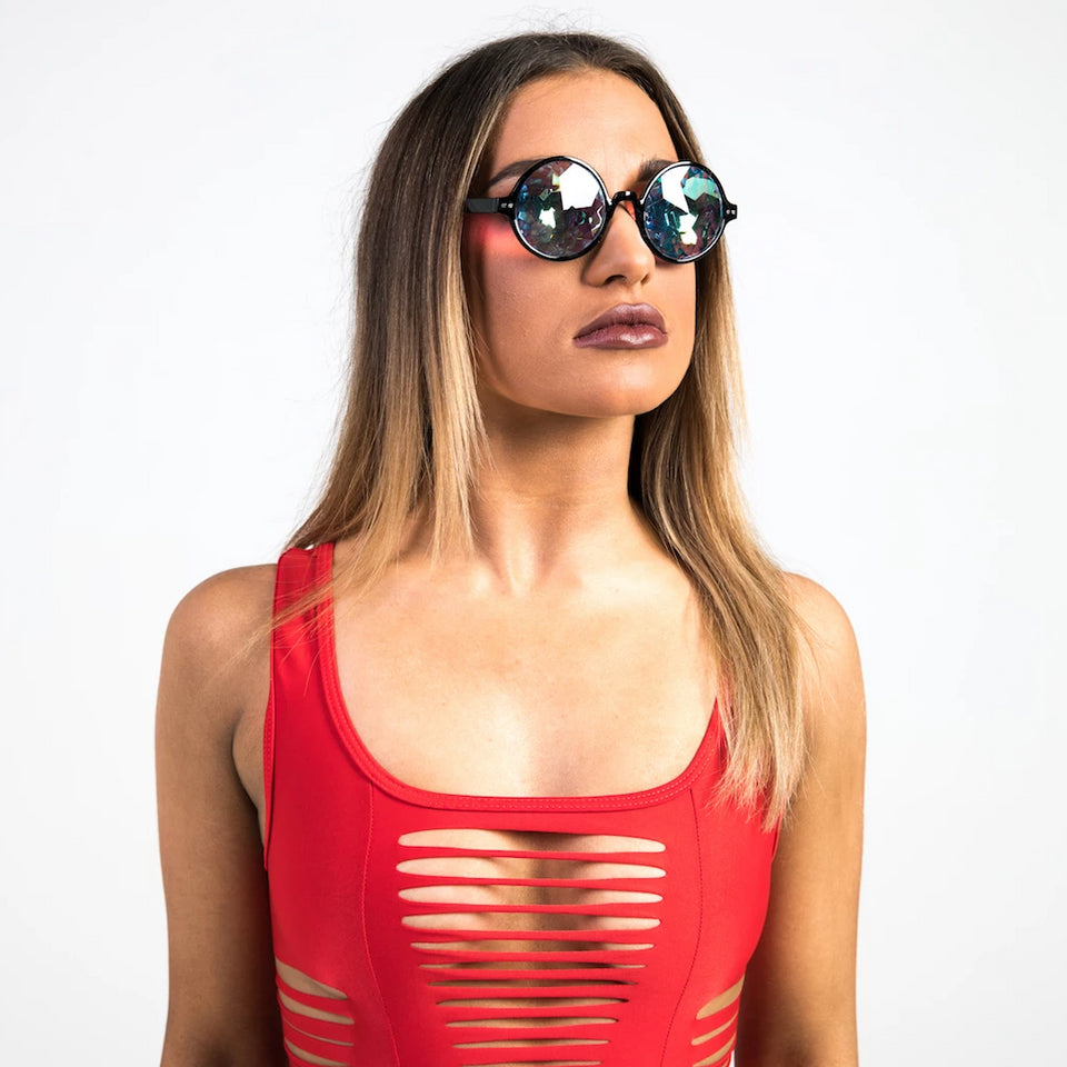 woman wearing black kaleidoscope sunglasses