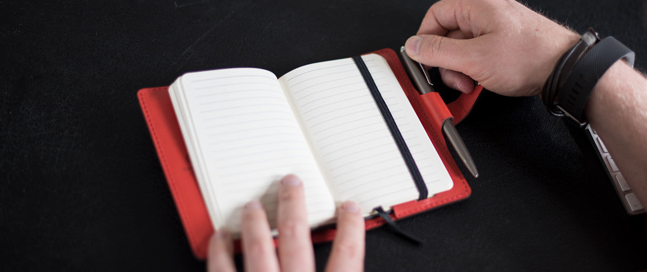 personalised leather A6 Notebook + Pen in use