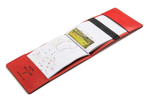Red personalized leather yardage book cover open
