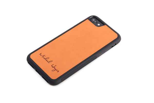 Tan personalized leather in a protective rubber case iPhone Case front