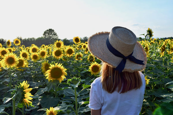 Evening at a sunflowers field. Vocco. Slow fashion.