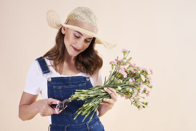 Gardener holding bouquet of cutting flowers