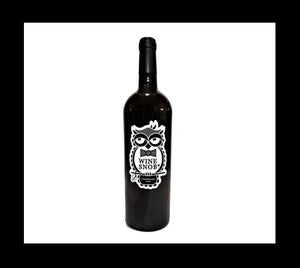 Bordeaux-style bottle with the Wine Snob* 2016 (T)rebelrouser label showing an owl perched on a stick with a leaf, slightly rolling its eyes, and wearing a black bowtie with white polka dots.