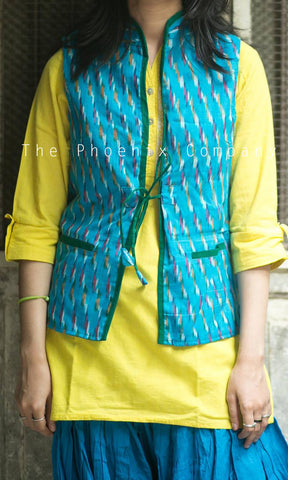 Light blue ikat & green jacket